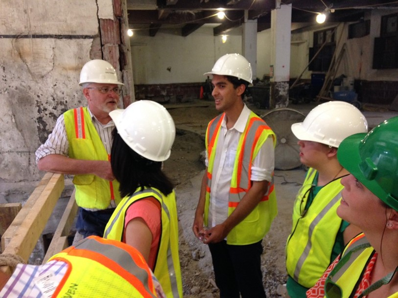 Summer Scholars on a construction education tour of The Cavalier, a local historic restoration project by Hanbury